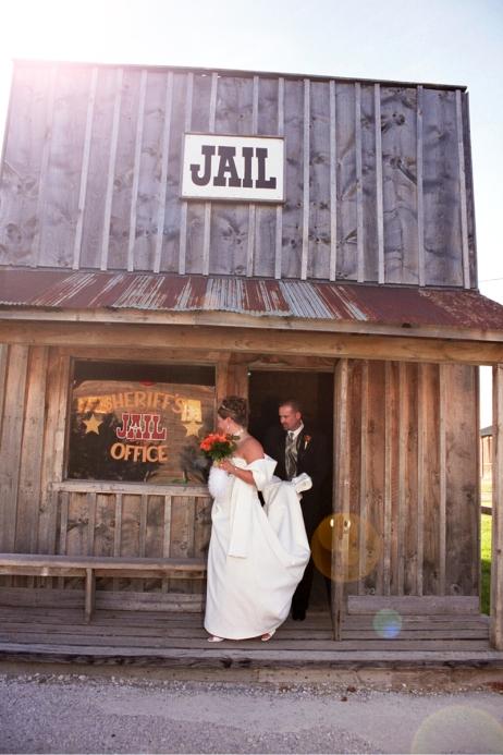 fun MN wedding photos - wedding couple stopping by jail